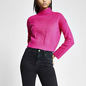 Pull court en tricot rose à col montant