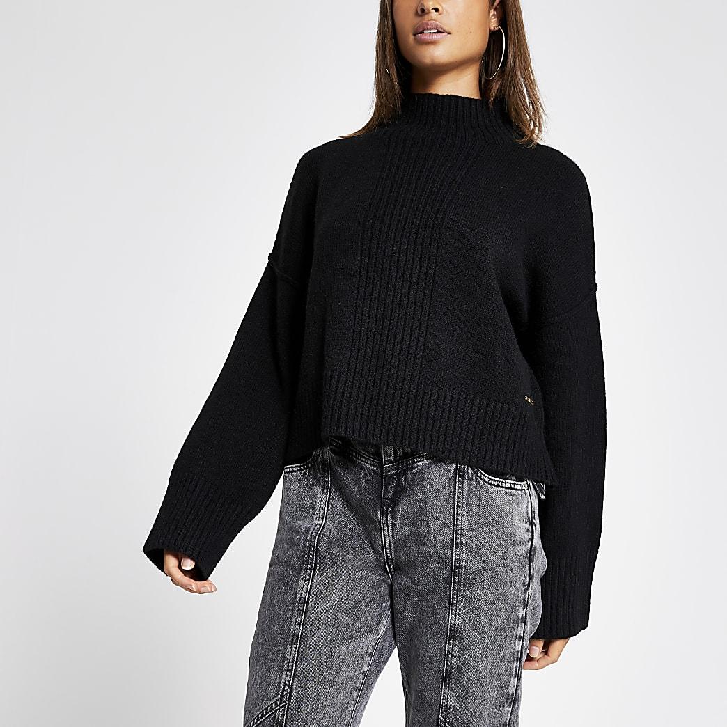 Zwarte hoogsluitende gebreide cropped pullover