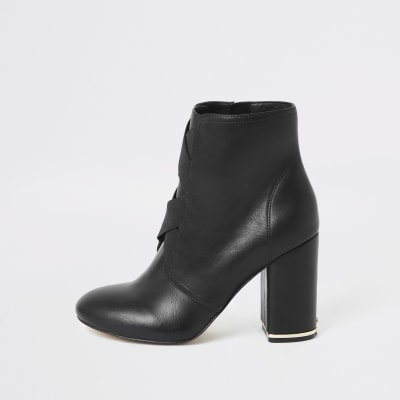 Black elasticated cross front heeled boots