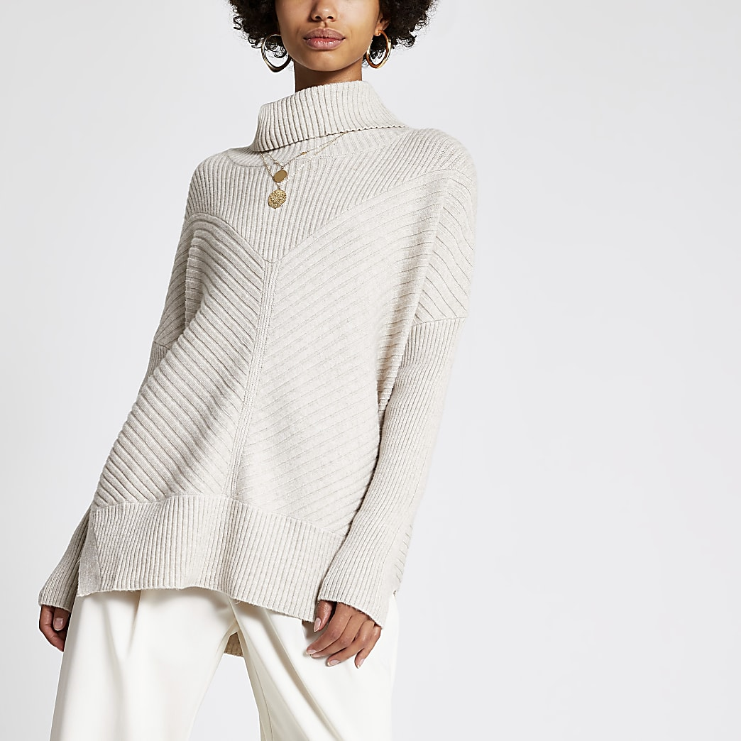 Light beige knitted rib roll neck jumper