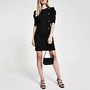 Mini robe en néoprène noire à manches bouffantes