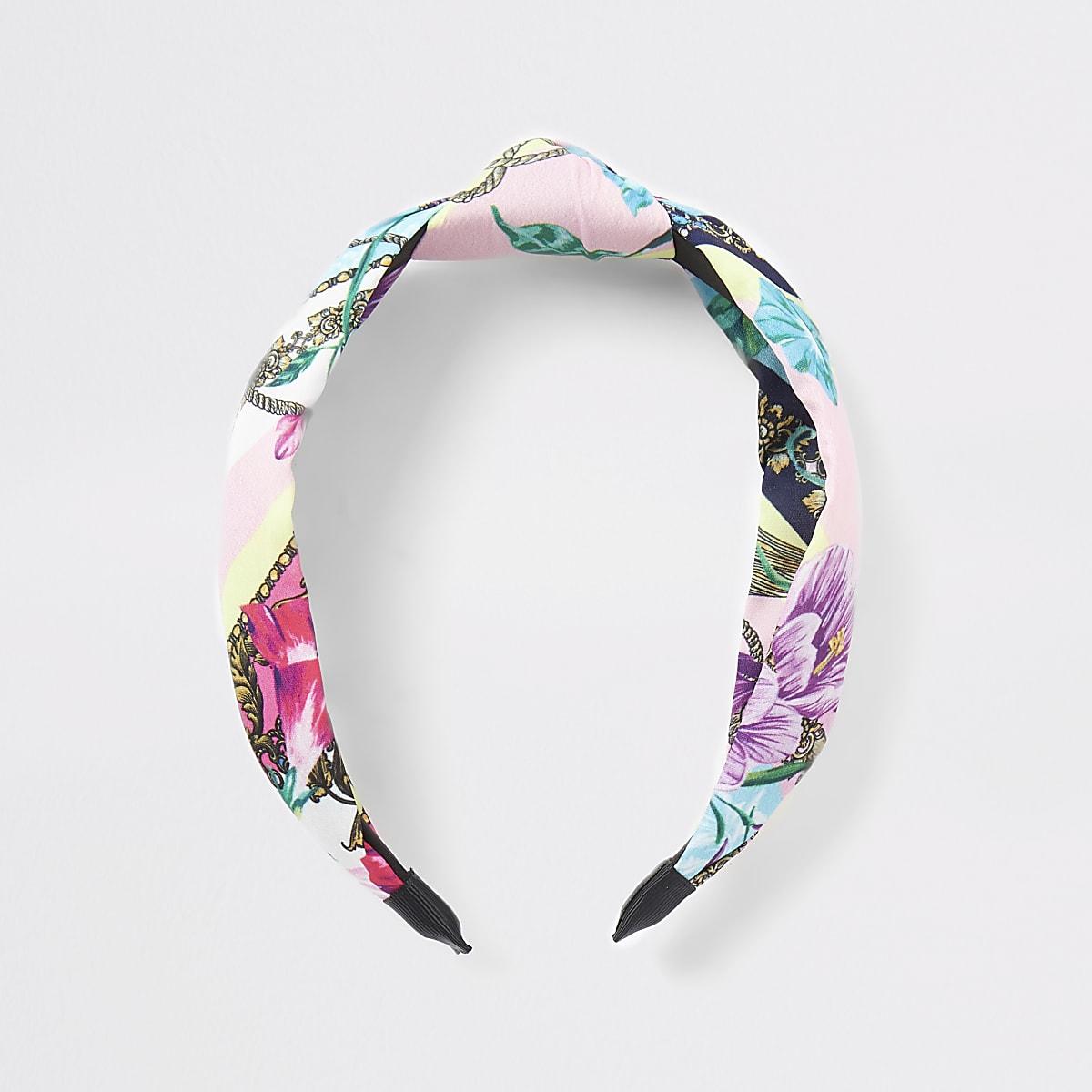 Roze hoofdband met knoop en bloemenprint