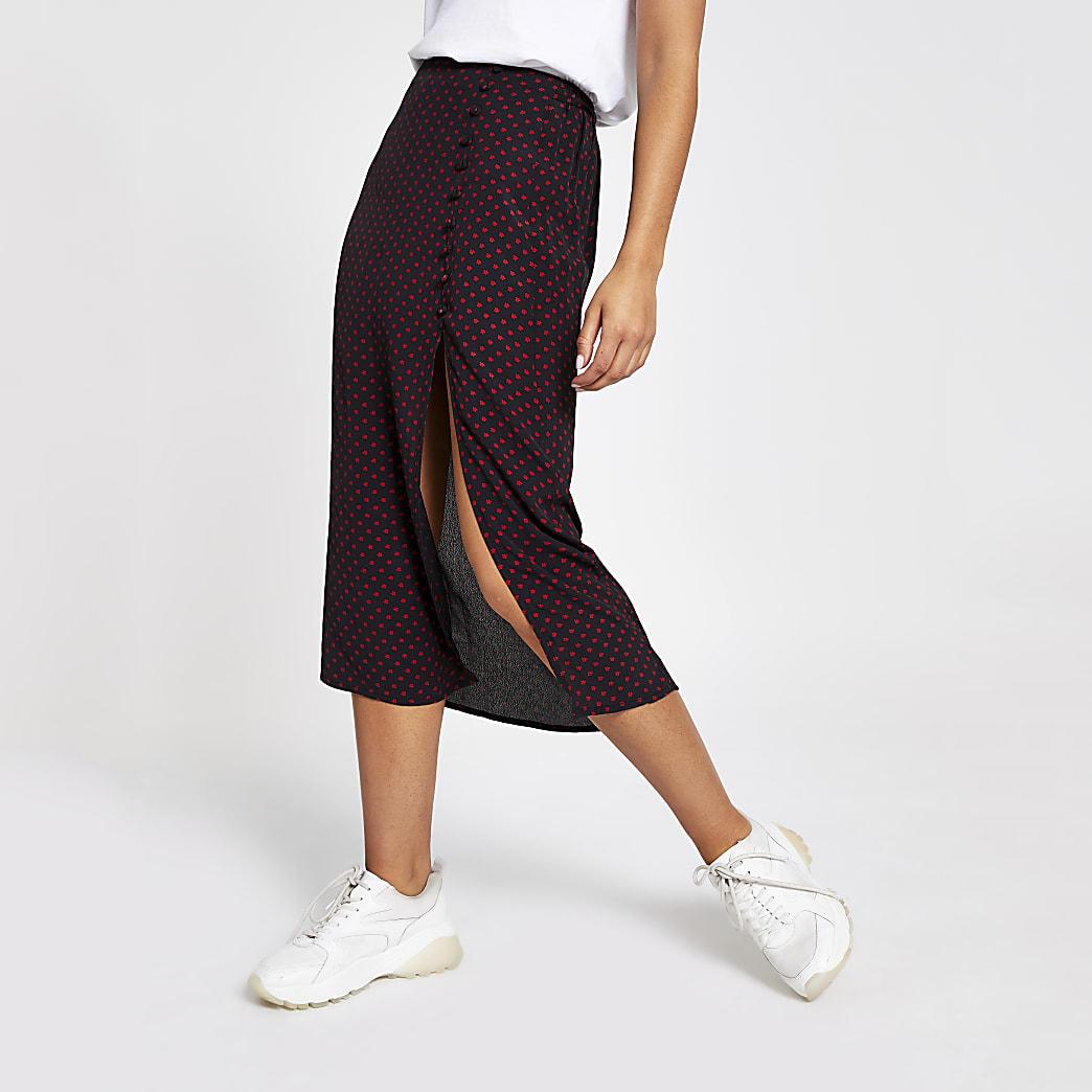 Jupe mi-longue imprimée noire à taille élastique