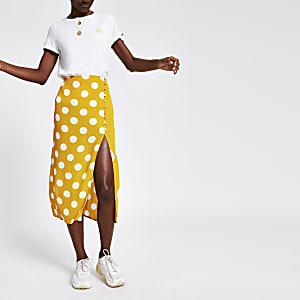 Jupe mi-longue jaune à pois et taille élastique