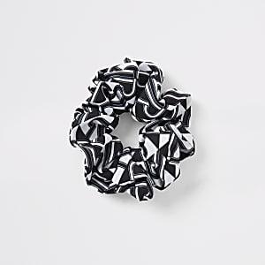 Schwarzes Haargummi mit RI-Print