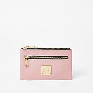 Roze mini portemonneemet rits en RI-logo
