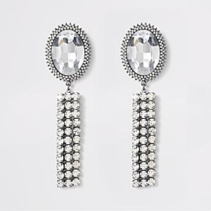 Zilverkleurige oorhangers met versierde kwastjes