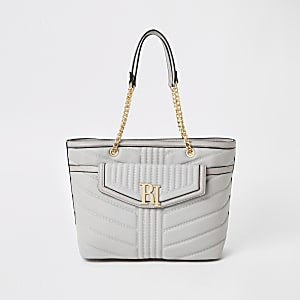 Light grey quilted front pocket tote bag