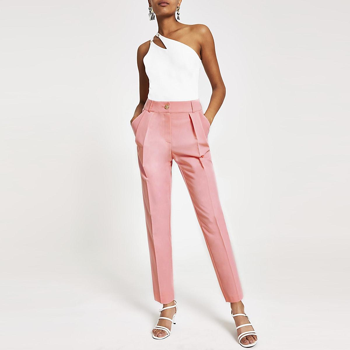 Roze geplooide smaltoelopende broek