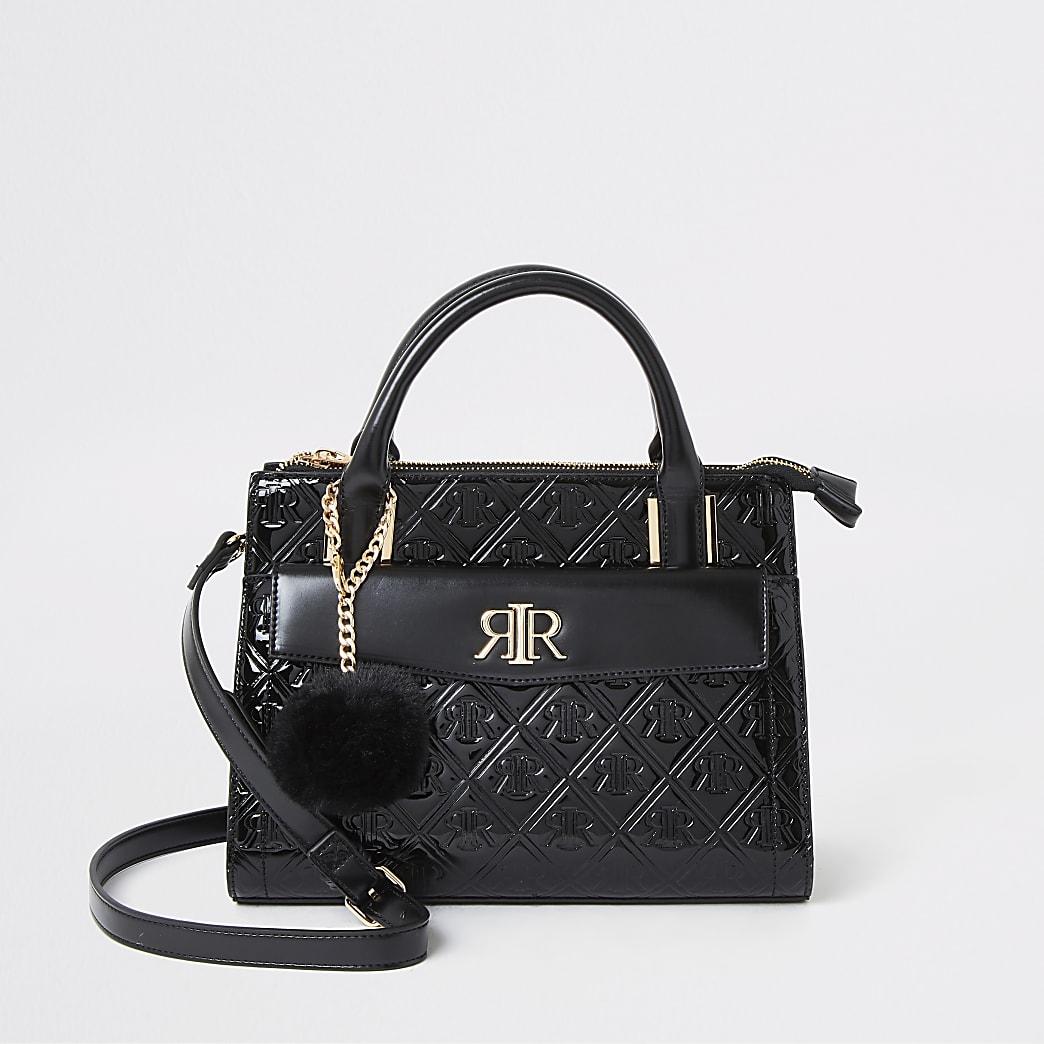 Zwarte handtas met RI in reliëf en voorvak