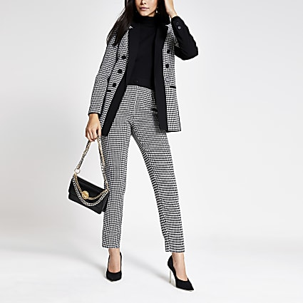 Black dogtooth pleated tapered peg trousers