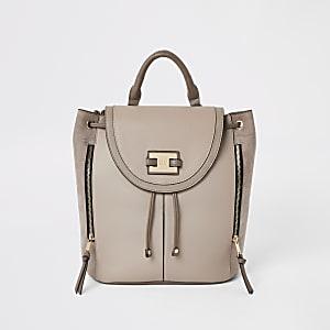 Light beige mink fold over backpack