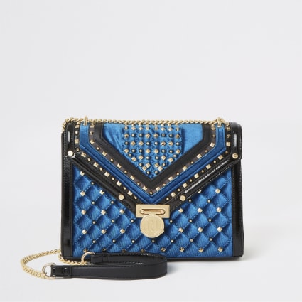Navy studded quilted cross body bag