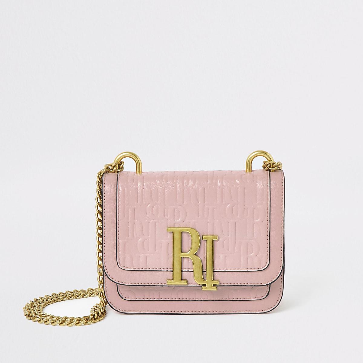 Light pink RI embossed mini cross body bag