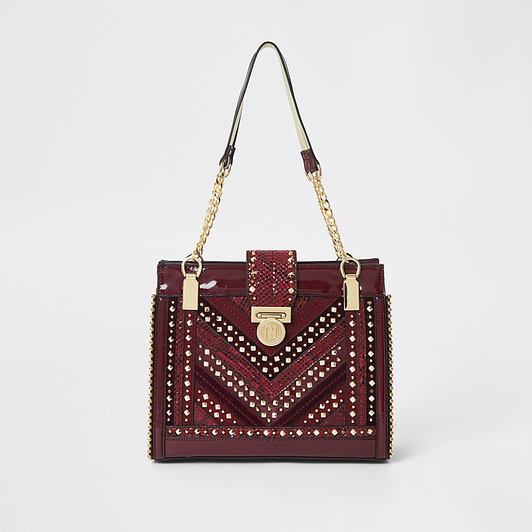 Red studded tote bag