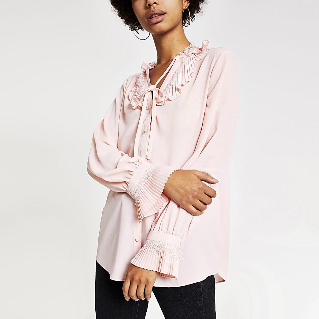 Pink lace trim tie neck blouse