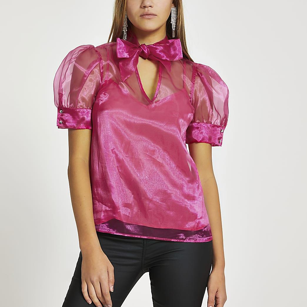 Roze blouse met strik om hals en doorschijnende pofmouwen