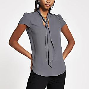 Grijze blouse met gestrikte hals en lange mouwen