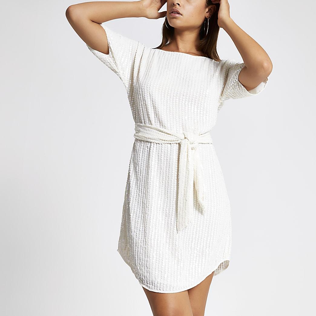 Crèmekleurige met pailletten verfraaide jurk met strikceintuur