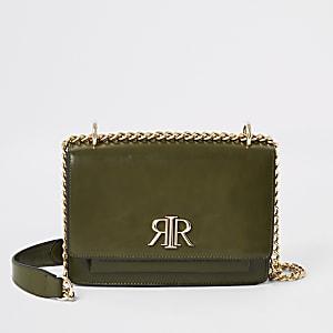Kaki satcheltasvoor onder de arm met RI-logo