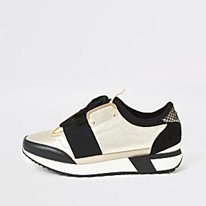 Goldene, dehnbare Lauf-Sneaker mit Schnürung