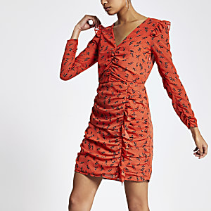 Oranje mini-jurk met ruches en bloemenprint