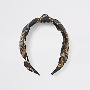 Bruine hoofdband met sjaalprint en knoop
