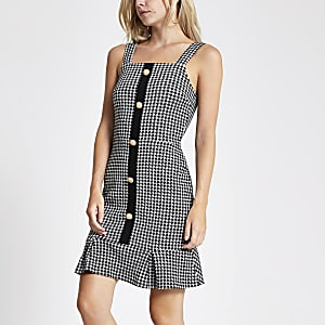 RI Petite - Zwarte mini-jurk met pied-de-poulemotief