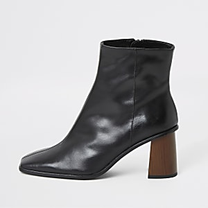 Zwarte leren laarzen met plateauzool en houten hak