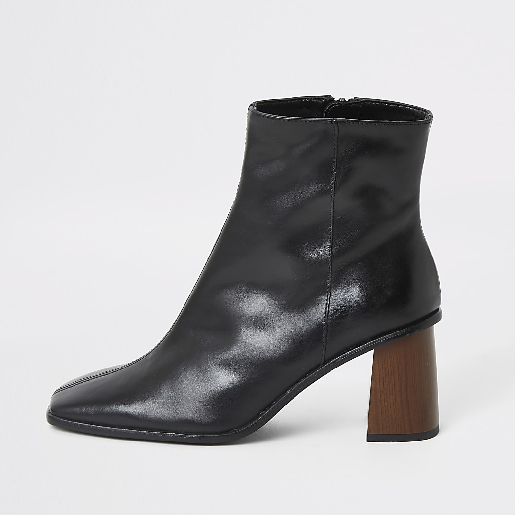 Black leather platform wood heel boots