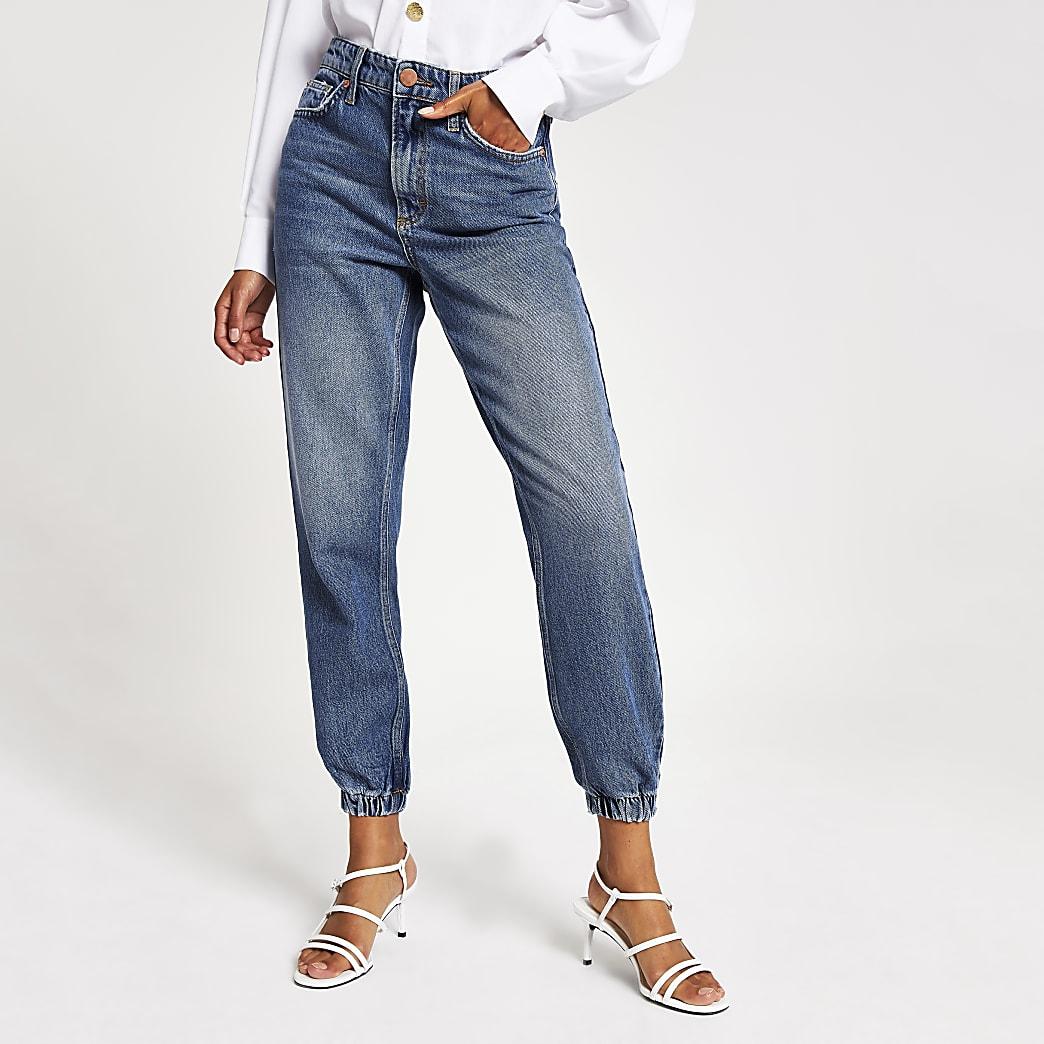 Jean bleu mi-délavé style pantalon de jogging