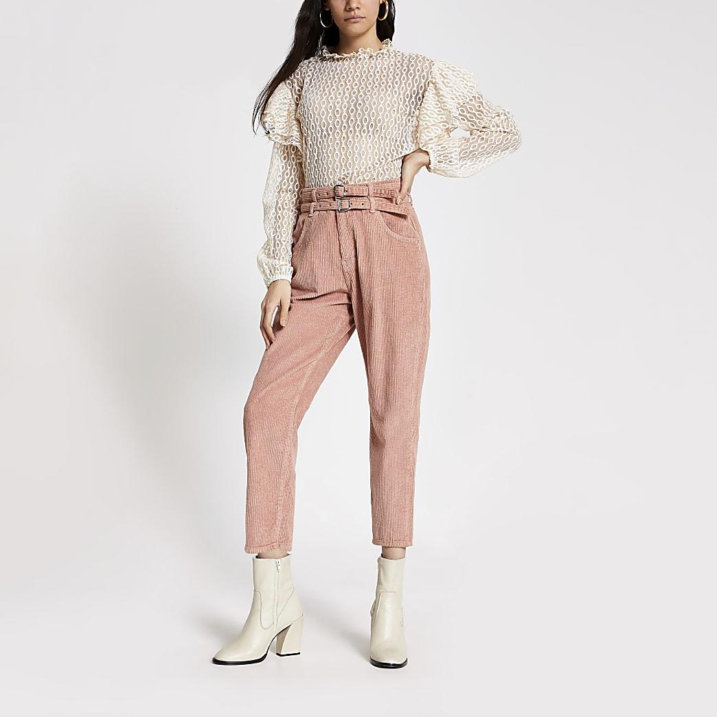 Roze jeans met corduroy bies en ceintuur