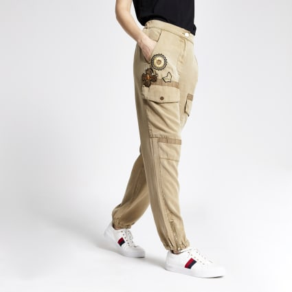 Beige embellished utility trousers