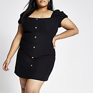 Zwarte geborduurde jurk met knopen en pofmouwen