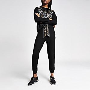Pantalons de jogging noirs avec ceinture en satin