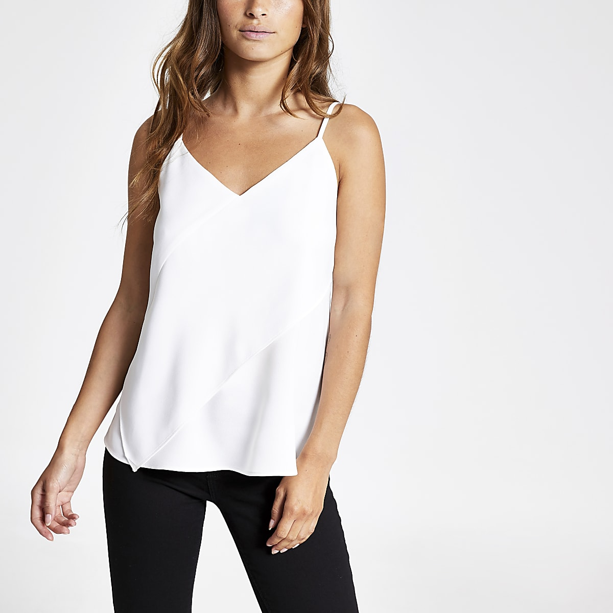 Petite white asymmetric cami top