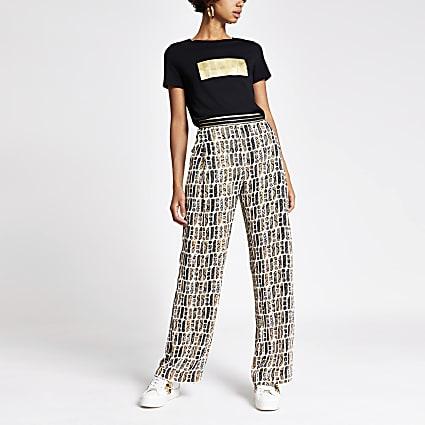 Brown RI monogram slim wide trousers
