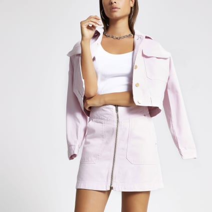 Light pink zip front mini denim skirt