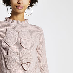 Roze gebreide pullover met lange mouwen en strikjes voor