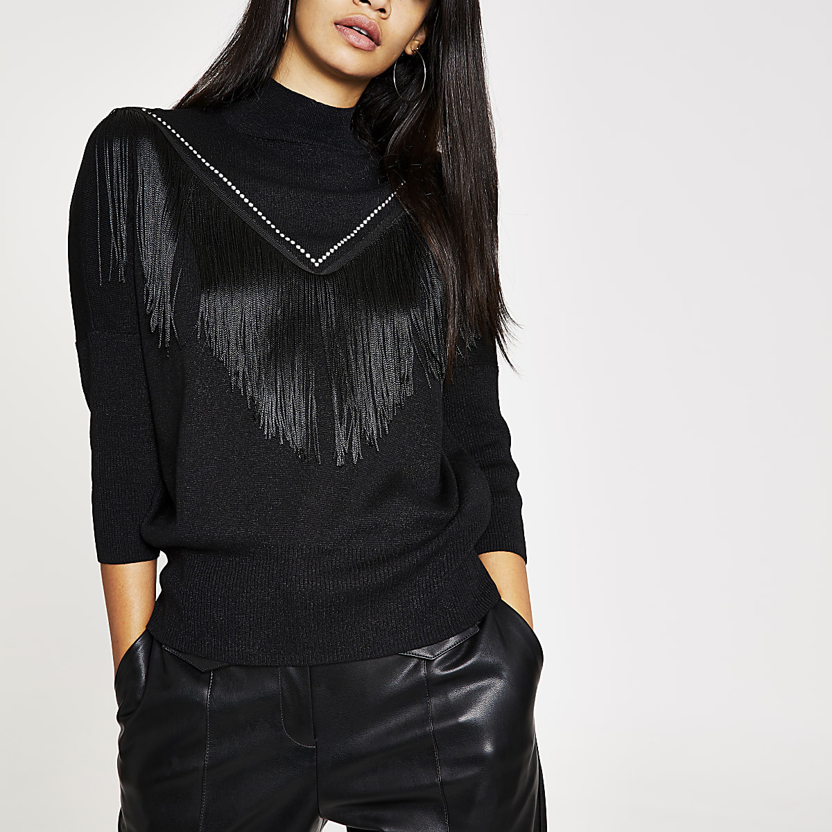 Zwarte gebreide pullover met franje en kwastjes