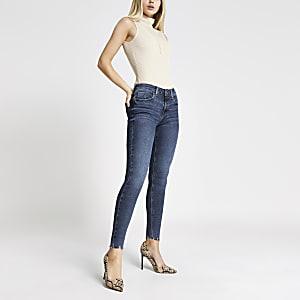 Amelie - Donkerblauwe superskinny jeans met gescheurde zoom