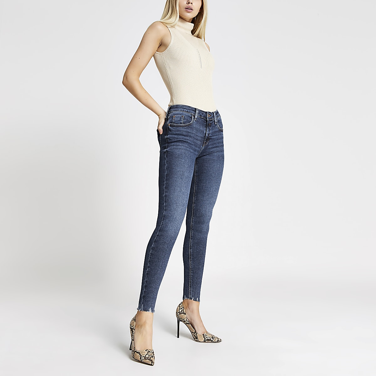 Dark blue Amelie rip hem super skinny jeans