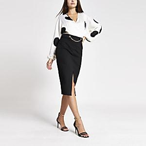 Zwarte midi-jurk met lange mouwen en stippen