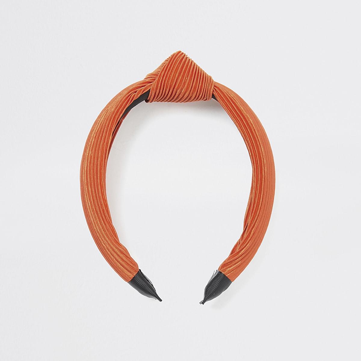 Oranje plissé hoofdband met knoop