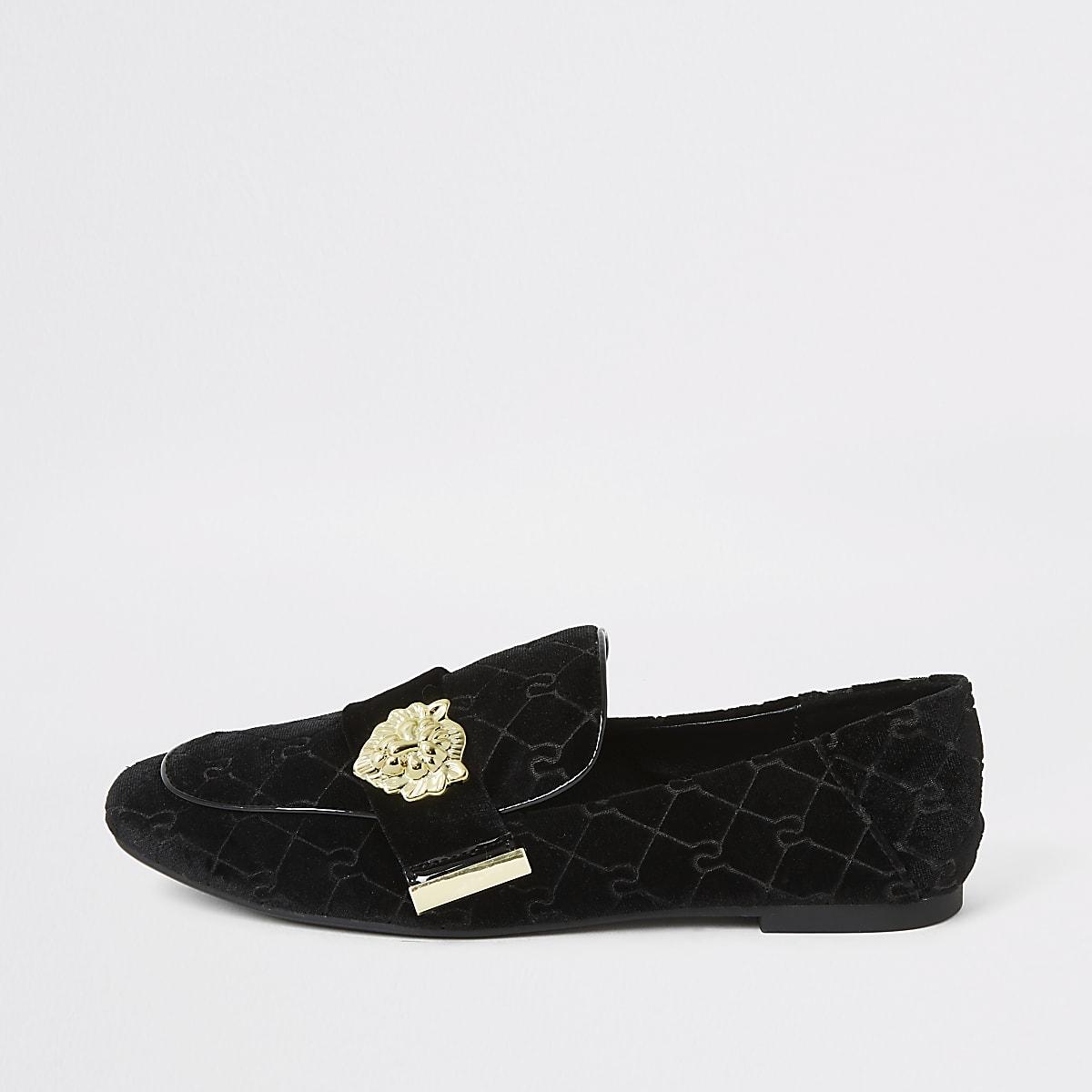 Zwarte fluwelen loafer met leeuw in reliëf en RI-logo