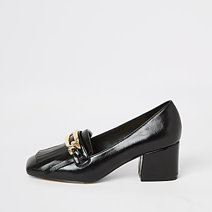 Black heeled snaffle tassel loafer
