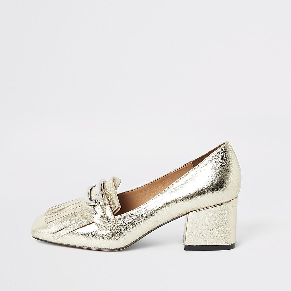 Goudkleurige loafers met kwastjeen hak