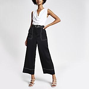 Pantalon large court noir avec surpiqûres contrastantes