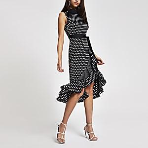 Forever Unique - Zwarte midi-jurk met stippen en print