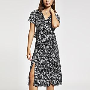 Zwarte midi-jurk met print en pofmouwen